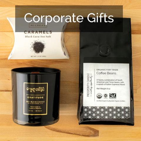 Custom corporate gifts that give back - soy candles handpoured in the U.S. by women artisans  at Prosperity Candle