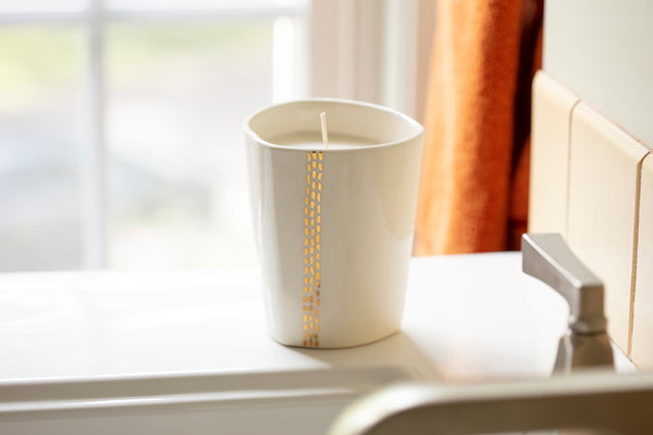Linnea Gold Candle - handpoured by women artisans in Massachusetts and handcrafted by Tandem Ceramics