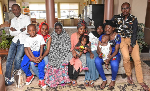 Artisan candle-maker Nyota and her loved ones after resettling to the U.S. from a refugee camp in Burundi