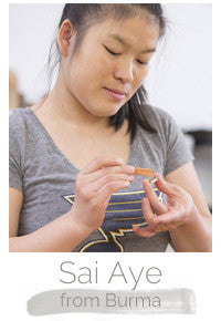 Sai Aye Burmese refugee makes handcrafted soy blend fair trade candles at Prosperity Candle