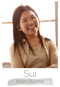 Sui a Burmese woman makes handcrafted soy blend fair trade candles at Prosperity Candle
