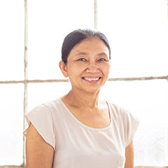 Tin Tin a Burmese refugee makes handcrafted fair trade soy blend artisan candles at Propserity Candle