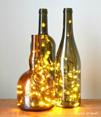 3 decorative wine bottle lamps - 5 Creative Upcycling DIY Ideas to Style your Home Sustainably on Prosperity Candle Blog