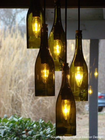 DIY wine bottle lamps hanging outdoors - 5 Creative Upcycling Ideas to Style your Home Sustainably on Prosperity Candle Blog
