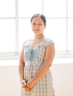 Moo Kho a Burmese refugee makes handcrafted fair trade soy blend artisan candles at Propserity Candle