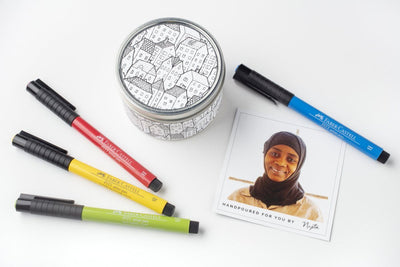 Doodle gift sets include a soy blend candle poured in the United States by women artisans. It includes artist pens by Faber + Castell and a story card about the woman who poured the candle. Perfect gift for teens.