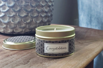Handmade soy blend candle made in the United States. A congratulations gift that gives back.