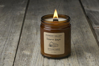 Fair trade soy blend candles handmade by women artisan refugees in Pioneer Valley Tobacco Barn with cedar and tobacco leaf, socially responsible