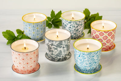 These soy blend candles turn into flower pots when the wax is gone! Poured in the United States by women artisans.