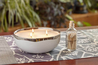 The Lulea Table Setter is a gift with impact and includes soy blend candles made in the United States and a handmade table runner. Perfect ethical housewarming gift.