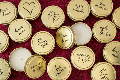Soy blend travel candles featuring words of affection throughout the year. Each fair trade candle is hand poured by a woman refugee in the United States. Best Valentine's Day present with a give back component.