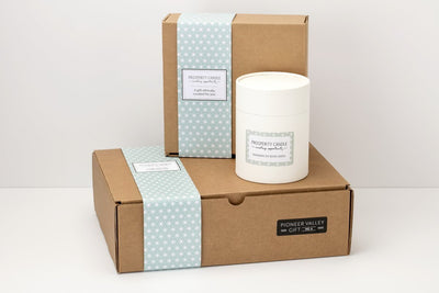 Prosperity Candle's elegant packaging houses our soy blend, fair trade candles.