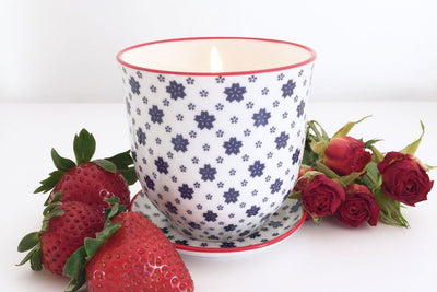 This snowflake Liberte pot is handmade by women artisans in the United States and repurposed as a flower pot when the wax is gpne. Soy blend candle.