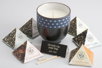 Great ethically curated gift for employees, board members and volunteers. Handmade soy blend candles poured by women refugees in the United States, and tea!