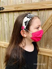 Little girl wearing headband and facemask
