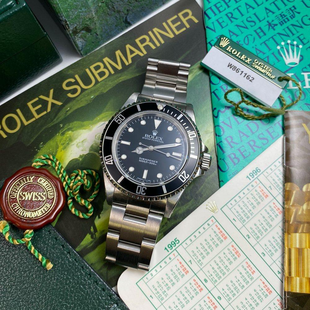 Rolex Submariner 14060 (1995 - W Serial) - Swiss Watch Trader