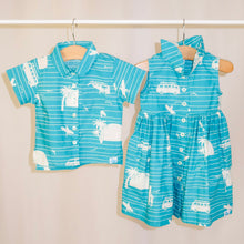 Load image into Gallery viewer, Children's Cosmo shirt in Surf's Up (teal)