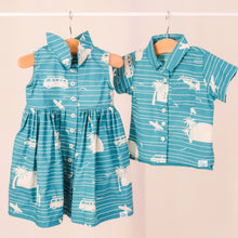 Load image into Gallery viewer, Our playful, button-up dress has just the right amount of poof and twirl.  The sleeveless style lets your child play with ease and we even added pockets so your littles can stow away their treasures.