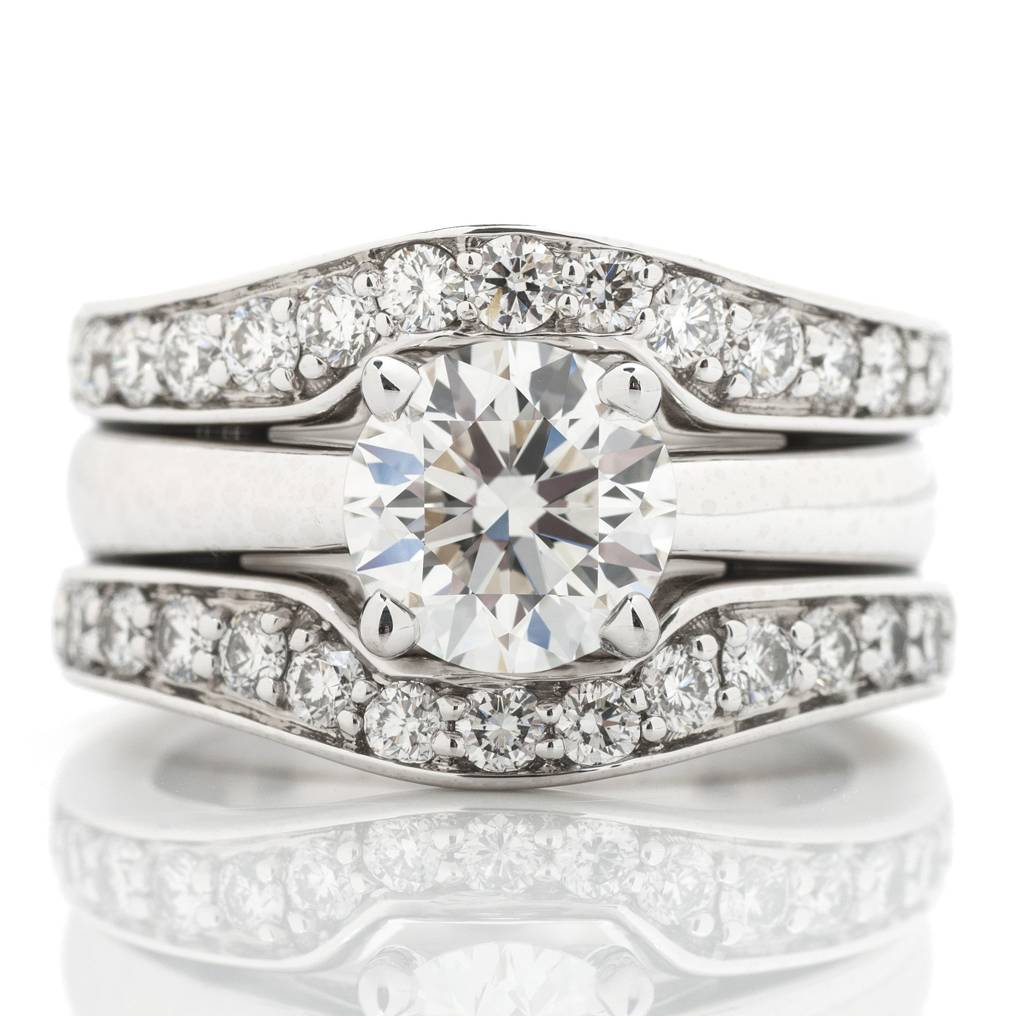 Platinum Statement Engagement Ring with Diamond Border