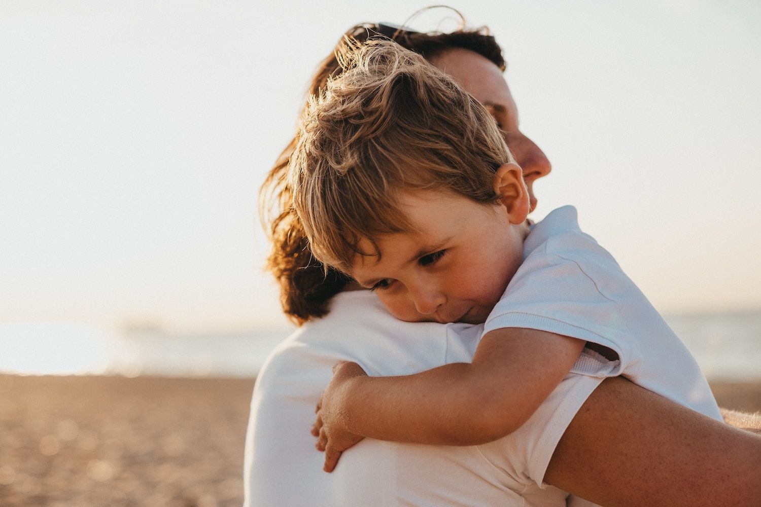 Mother and Son Hugging - What is Mindful Parenting? Emotion Regulation Strategies for Families