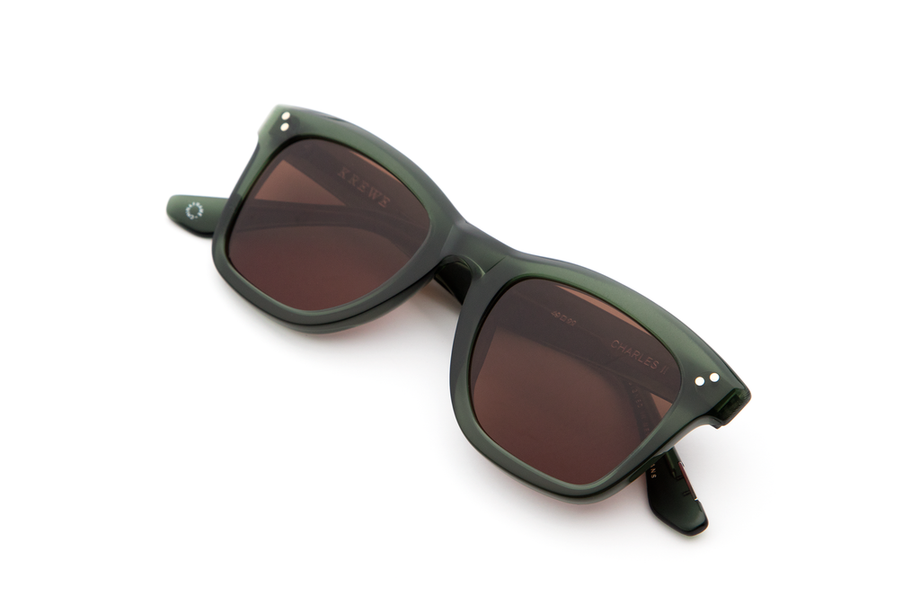 Inspired by St. Charles Avenue, Charles II is an update on the classic wayfarer, featuring hand-beveled edges, custom temple wire, and pinned hinges.  Free shipping and lifetime warranty.  Amber lens and handcrafted bottle green acetate frame.