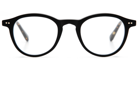 With a combination of lightweight titanium and acetate, Claude's rounded, '60s-inspired silhouette is an updated take on a classic fit.  These frames come with a lifetime warranty and are eligible for free shipping and free returns.  Features matte black acetate and 12K titanium hardware.