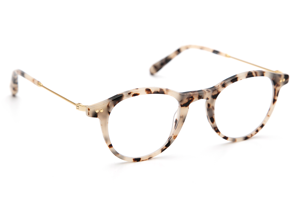 With a combination of lightweight titanium and acetate, Claude's rounded, '60s-inspired silhouette is an updated take on a classic fit. These frames come with a lifetime warranty and are eligible for free shipping and free returns.  Features handcrafted matte oyster acetate frame and 18K titanium hardware.