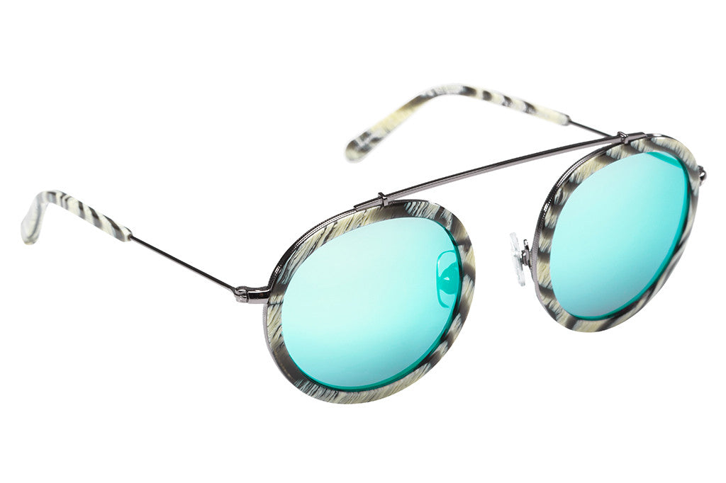 Named for the vibrant French Quarter street, Conti boasts a metal structure, rounded lenses, and a unique brow bridge that provides a seemingly weightless fit, creating an everyday frame unlike any other. As seen on Gigi Hadid. Free shipping and lifetime warranty.  Seafoam mirrored lens and handcrafted bone acetate frame.