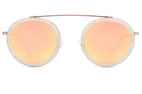 Named for the vibrant French Quarter street, Conti boasts a metal structure, rounded lenses, and a unique brow bridge that provides a seemingly weightless fit, creating an everyday frame unlike any other. As seen on Gigi Hadid. Free shipping and lifetime warranty.  Rose gold mirrored lens and handcrafted matte opal acetate frame with 24K rose gold plated hardware .