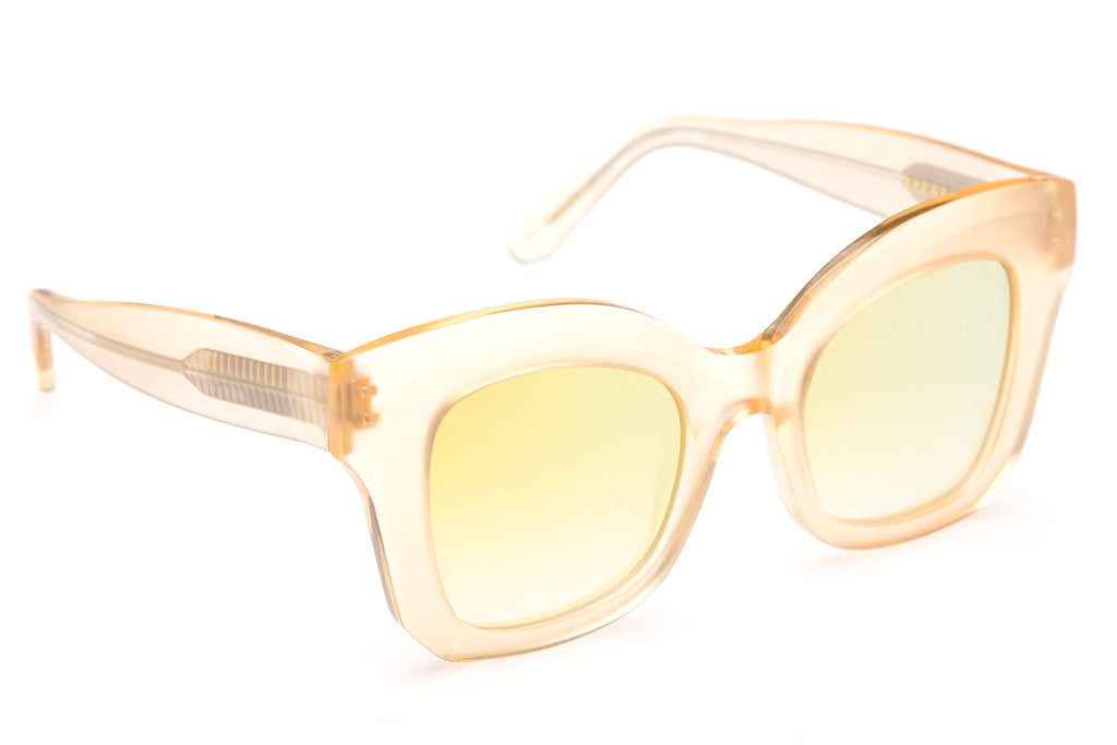 Beveled temples, flat lenses, and a square silhouette make Dauphine the ultimate oversized statement frame.  Free shipping and lifetime warranty. Features gold gradient mirrored flat lens and handcrafted matte champagne acetate frame.