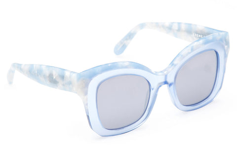Beveled temples, flat lenses, and a square silhouette make Dauphine the ultimate oversized statement frame.  Free shipping and lifetime warranty. Features silver mirrored flat lens and handcrafted matte ciel to blue crystal acetate frame.