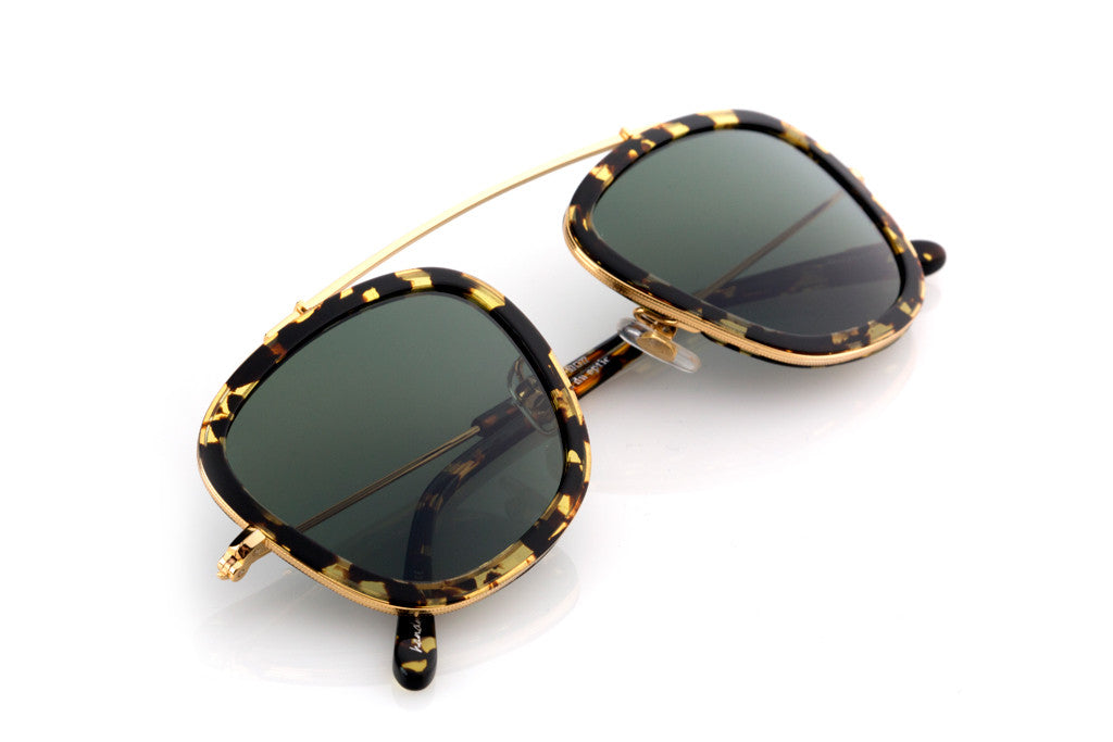 Inspired by the high arching lines of New Orleans' famed Mississippi River bridge, Huey's lightweight, flexible bridge and square silhouette embody a unisex style and swagger.  Free shipping and lifetime warranty.  Green polarized lens and handcrafted zulu acetate frame with 24K gold plated hardware.