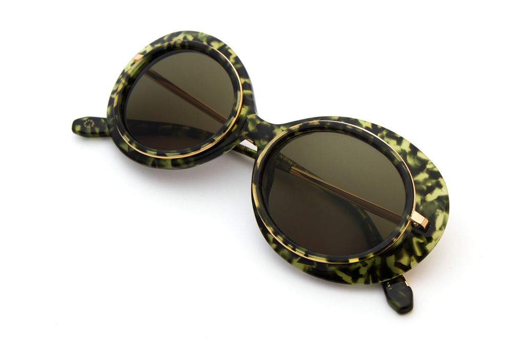 Named for the all-female Mardi Gras krewe, Iris features hand-carved acetate united with a custom metal rim wire. Its oblong shape makes for a bold statement frame.  As seen on Gigi Hadid. Free shipping and lifetime warranty.  Features green lens and handcrafted absinthe acetate frame with 24K plated gold hardware.