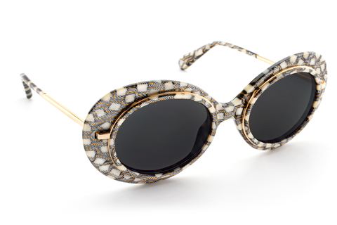 Named for the all-female Mardi Gras krewe, Iris features hand-carved acetate united with a custom metal rim wire. Its oblong shape makes for a bold statement frame.  As seen on Gigi Hadid. Free shipping/ free returns and lifetime warranty.  Features grey lenses and handcrafted custom Stella acetate frame with 24K plated gold hardware.