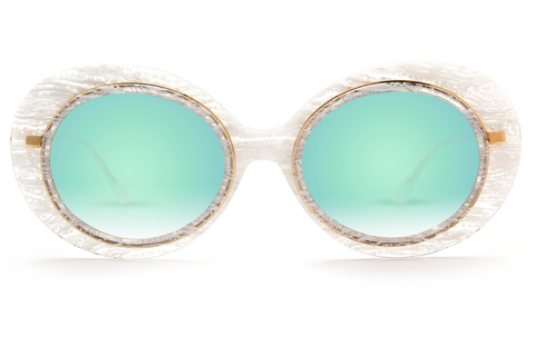 Named for the all-female Mardi Gras krewe, Iris features hand-carved acetate united with a custom metal rim wire. Its oblong shape makes for a bold statement frame.  As seen on Gigi Hadid. Free shipping and lifetime warranty.  Features seafoam gradient mirrored lens and handcrafted white linen acetate frame with 24K plated gold hardware.