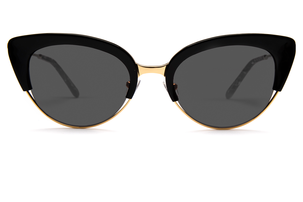 Hand-carved acetates merge seamlessly with accentuated angles for an ultra modern cat-eye, perfect for the sophisticated risk taker.  As seen on Elizabeth Olsen. Free shipping and lifetime warranty. Grey lens and handcrafted black acetate frame with 24K gold plated hardware.