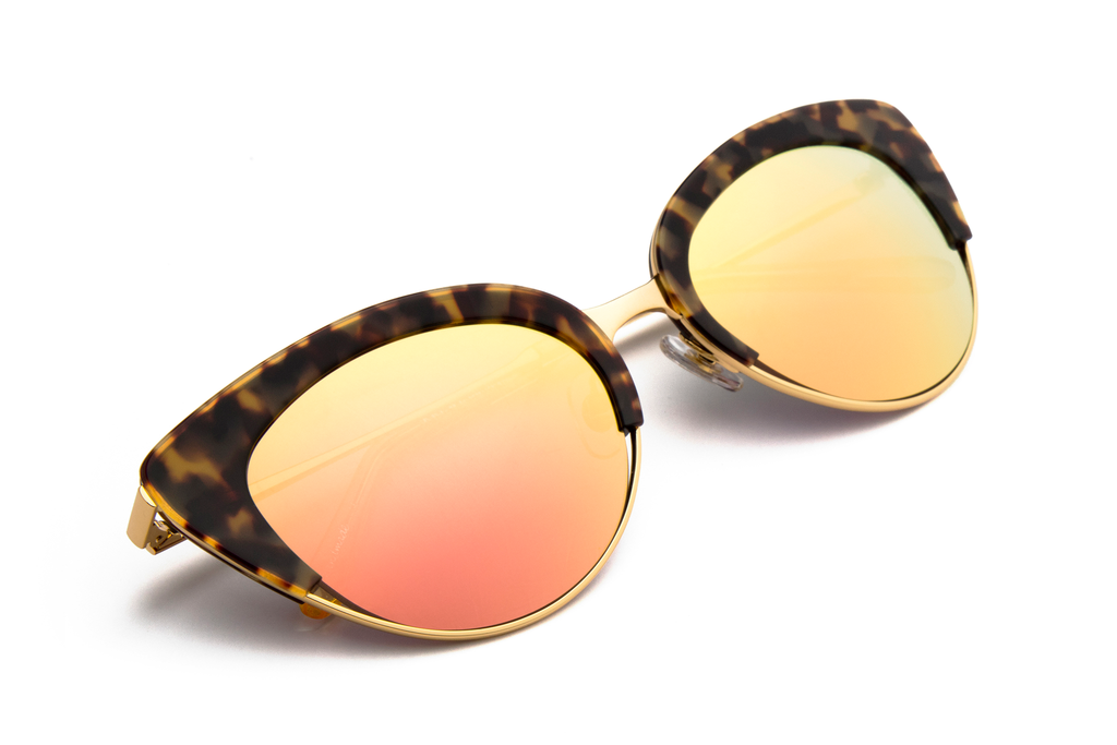 Hand-carved acetates merge seamlessly with accentuated angles for an ultra modern cat-eye, perfect for the sophisticated risk taker.  As seen on Elizabeth Olsen. Free shipping and lifetime warranty. Rose mirrored lens and handcrafted blonde tortoise acetate frame with 24K gold plated hardware.