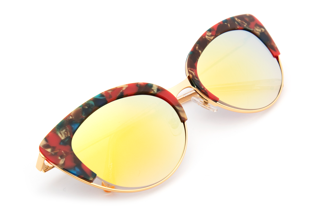 Hand-carved acetates merge seamlessly with accentuated angles for an ultra modern cat-eye, perfect for the sophisticated risk taker.  As seen on Elizabeth Olsen. Free shipping and lifetime warranty. Gold gradient mirrored lens and handcrafted carnevale acetate frame with 24K gold plated hardware.