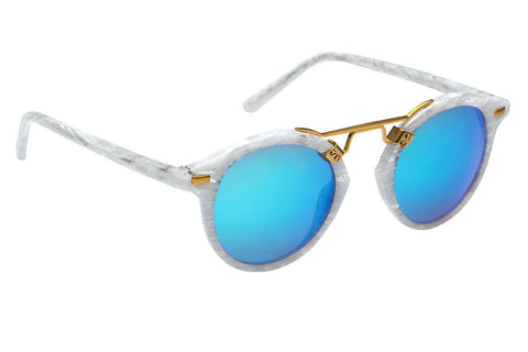 St. Louis While Linen boasts a 24K bridge, rounded blue mirrored lenses and a retro-inspired silhouette making it a celebrity favorite.  Gigi Hadid, Kendall Jenner, Adriana Lima, Selena Gomez, Dakota Fanning, and Michiel Huisman all own a pair. These best-selling sunglasses are crafted from acetate and derive inspiration from the French Quarter's iconic cast-iron balconies. Free shipping and lifetime warranty.