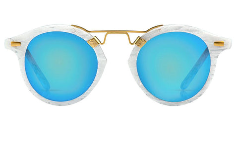 St. Louis While Linen boasts a 24K bridge, rounded blue mirrored lenses and a retro-inspired silhouette making it a celebrity favorite.  Gigi, Kendall, Adriana Lima, Selena Gomez and Dakota Fanning all own a pair. These best-selling sunglasses are crafted from acetate and derive inspiration from the French Quarter's iconic cast-iron balconies. Free shipping both ways.