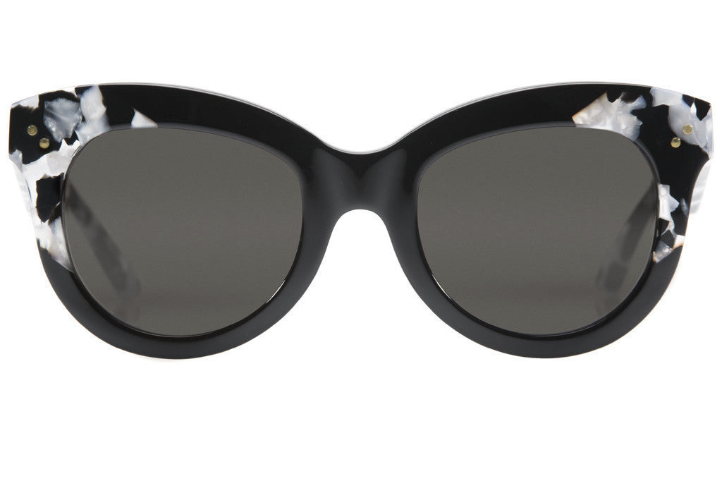 Julia exhibits the downtown vibe of the main gallery thoroughfare in New Orleans' Arts District, with an oversized shape that exudes effortless glamour.  As seen on Reese Witherspoon and Hailey Baldwin. Free shipping and lifetime warranty. Grey lens and black and interstellar handcrafted acetate frame.
