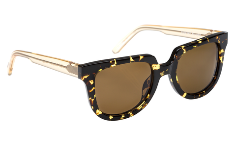 Lyons is a contemporary take on the iconic wayfarer silhouette, with a flat-top shape that is perfect for everyday wear.  Free shipping and lifetime warranty.  This frame features amber polarized lenses and a handcrafted zulu and champagne acetate frame.