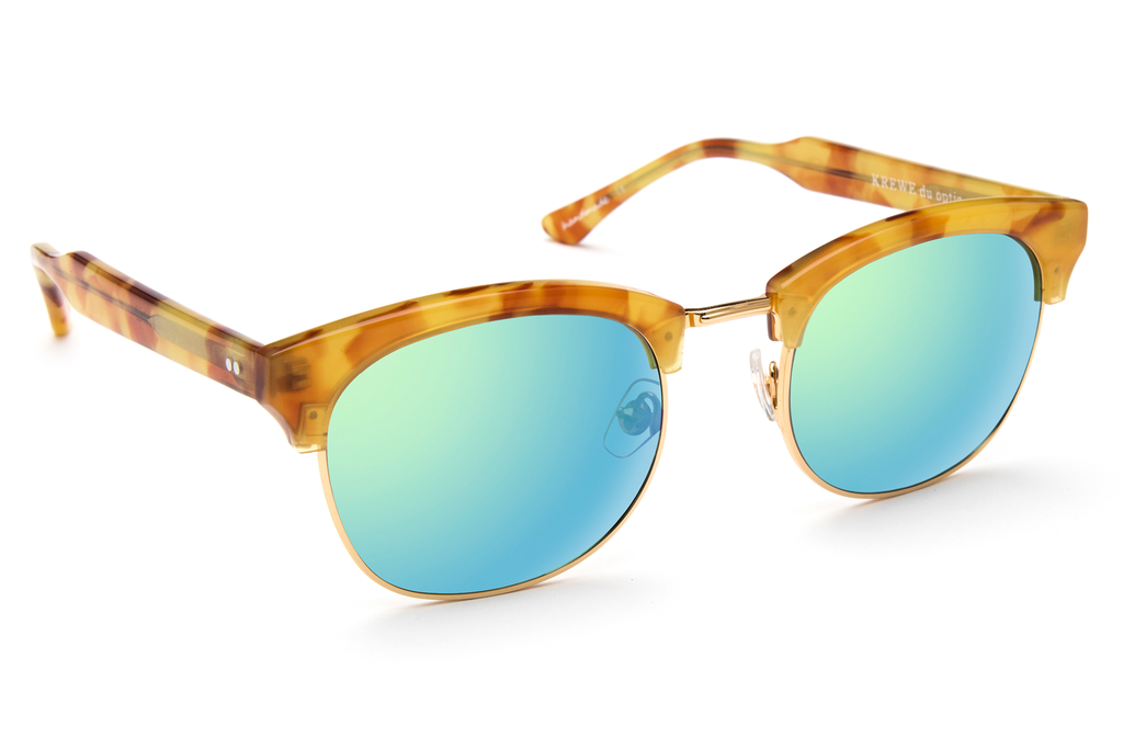 The L•G•D embodies the elegant, free-spirited style of the Lower Garden District. Crafted from acetate and metal, the retro-inspired silhouette is a modern classic.  As seen on Jimmy Butler and Amber Heard. Free shipping and lifetime warranty.  Seafoam mirrored lens and handcrafted rum acetate frame with 24K gold plated hardware.