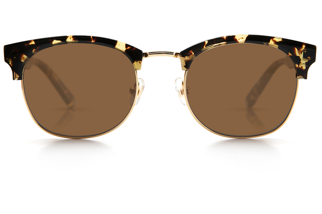 The L•G•D embodies the elegant, free-spirited style of the Lower Garden District. Crafted from acetate and metal, the retro-inspired silhouette is a modern classic.  As seen on Jimmy Butler and Amber Heard. Free shipping and lifetime warranty.  Amber polarized lens and handcrafted zulu acetate frame with 24K gold plated hardware.