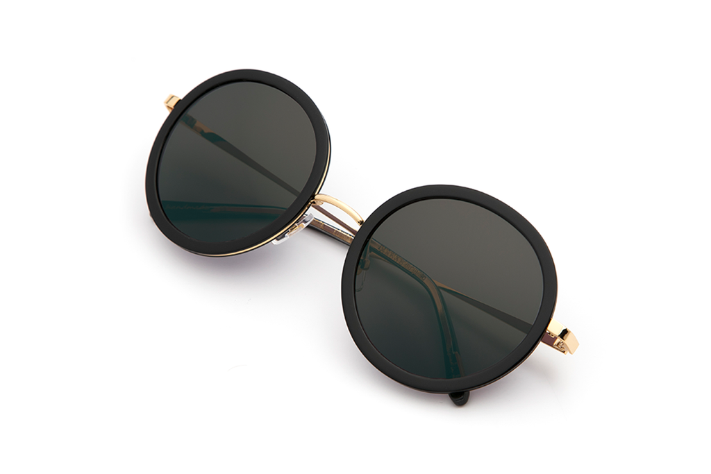 Louisa's modern design— with oversized round lenses and a full metal structure— derives inspiration from both the classic Windsor silhouette and its eclectic Bywater street namesake.  As seen on Kate Hudson. Free shipping and lifetime warranty.  Grey lens and handcrafted black acetate frame with 24K gold plated hardware.
