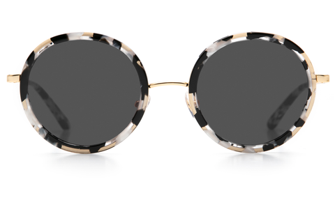 Louisa's modern design— with oversized round lenses and a full metal structure— derives inspiration from both the classic Windsor silhouette and its eclectic Bywater street namesake.  As seen on Kate Hudson. Free shipping and lifetime warranty.  Grey lens and handcrafted interstellar acetate frame with 24K gold plated hardware.