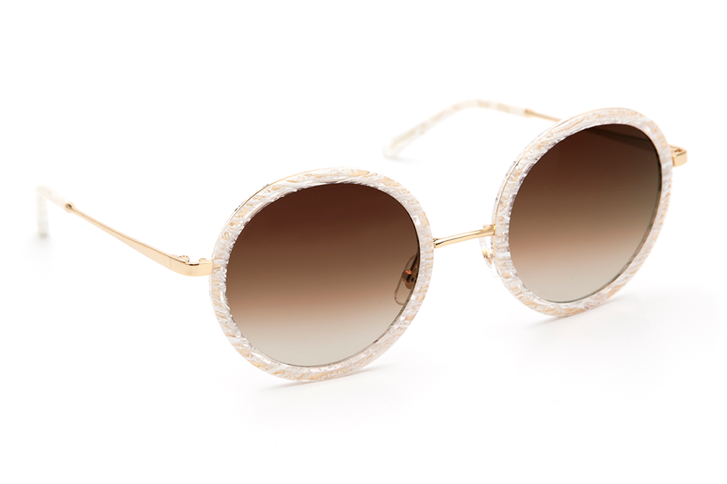 Louisa's modern design— with oversized round lenses and a full metal structure— derives inspiration from both the classic Windsor silhouette and its eclectic Bywater street namesake.  As seen on Kate Hudson. Free shipping and lifetime warranty.  Grey lens and handcrafted white linen acetate frame with 24K gold plated hardware.
