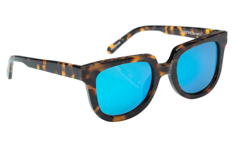 Lyons is a contemporary take on the iconic wayfarer silhouette, with a flat-top shape that is perfect for everyday wear.  Free shipping and lifetime warranty.  Blue mirrored lens and handcrafted blonde tortoise acetate frame.