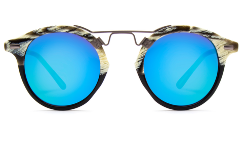 St. Louis Bone to Black boasts a 24K bridge, rounded blue mirrored lenses and a retro-inspired silhouette making it a celebrity favorite.  Gigi, Kendall, Adriana Lima, Selena Gomez and Dakota Fanning all own a pair. These best-selling sunglasses are crafted from acetate and derive inspiration from the French Quarter's iconic cast-iron balconies. Free shipping both ways.