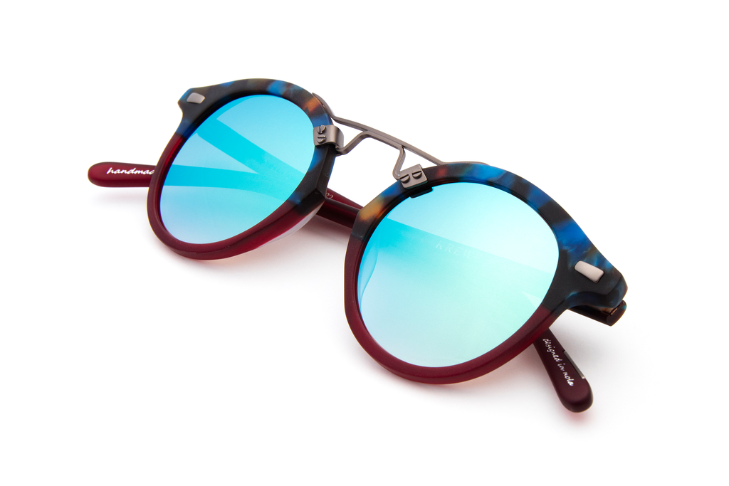 St. Louis Blue Steel to Burgundy boasts a brushed metal bridge, rounded seafoam gradient mirrored lenses and a retro-inspired silhouette making it a celebrity favorite.  Gigi Hadid, Kendall Jenner, Adriana Lima, Selena Gomez, Dakota Fanning, Michiel Huisman, Beyonce, Julianne Hough, Kate Hudson, and Olivia Culpo all own a pair. These best-selling sunglasses are crafted from acetate and derive inspiration from the French Quarter's iconic cast-iron balconies. Free shipping both ways.